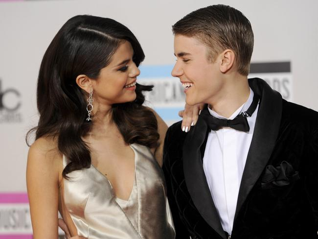 Happier times ... Selena Gomez and Justin Bieber arrive at the 39th Annual American Music Awards in November 2011.