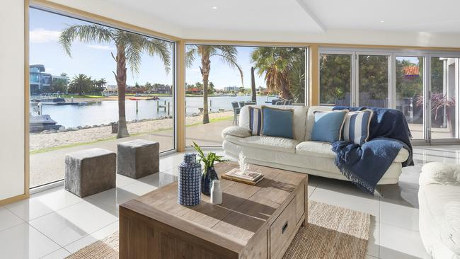 The living space looks out to water views.