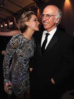 Jennifer Lawrence getting pretty pretty pretty close to 'Seinfeld' producer Larry David at the 2014 Vanity Fair Oscar Party. Picture: WireImage