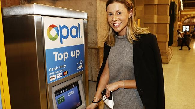 No wonder this commuter is smiling, she has found a top-up machine without a queue...