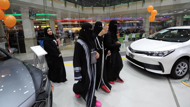 Tyre kicking: Saudi women tour a car showroom for women. By June, they hope they'll be driving them. The showroom is staffed by women only. Picture: AFP