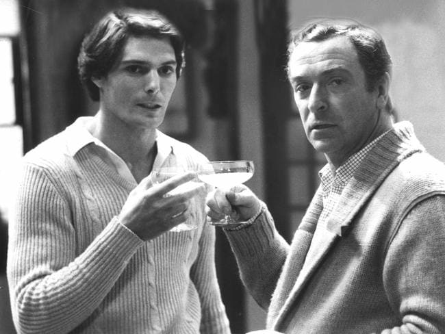 Caine (R) partied hard when he was younger, seen here with actor Christopher Reeve in 1982.