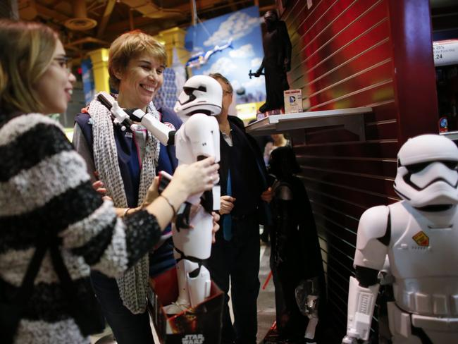 Two shoppers look at a Stormtrooper toy from Star Wars at a Toys R Us store. Picture: Getty