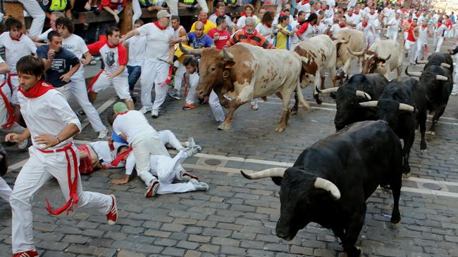 Dodging bulls, and each other, through the streets of Pamplona