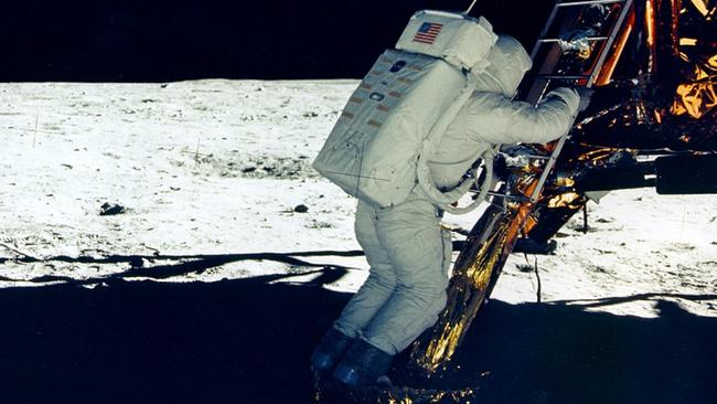 Buzz Aldrin makes his first steps on the surface.