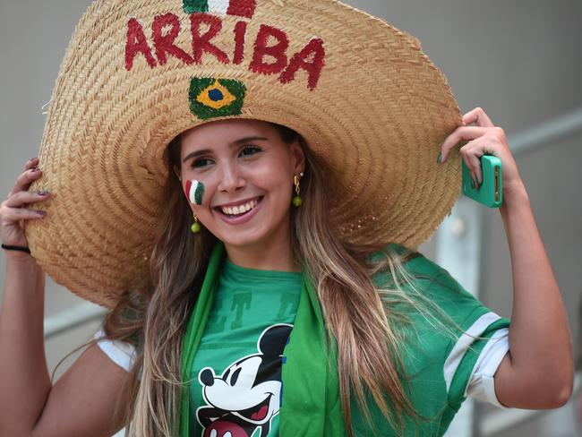 A Mexico fan cheers prior to a Round of 16 football match between Netherlands and Mexico.