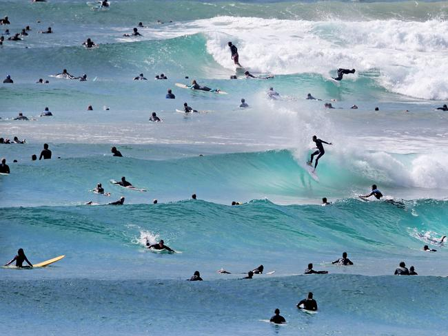 Near-perfect surf conditions brought out board riders of all ages on the Coolangatta-Tweed Heads coast yesterday. Picture: Luke Marsden