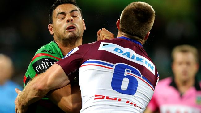 Ben Te'o is tackled by Kieran Foran in Friday night's blockbuster clash between Souths and Manly. Pic: Gregg Porteous