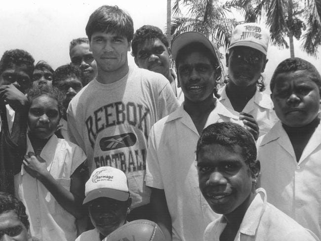 Che Cockatoo-Collins took a break from pre-season training to stress the importance of education to Top End school students in Darwin in 1996.