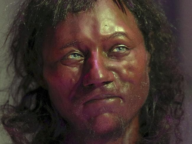 DNA from a 10,000-year-old skeleton found in an English cave suggests he had dark skin and blue eyes. Picture: Jonathan Brady/PA via AP.