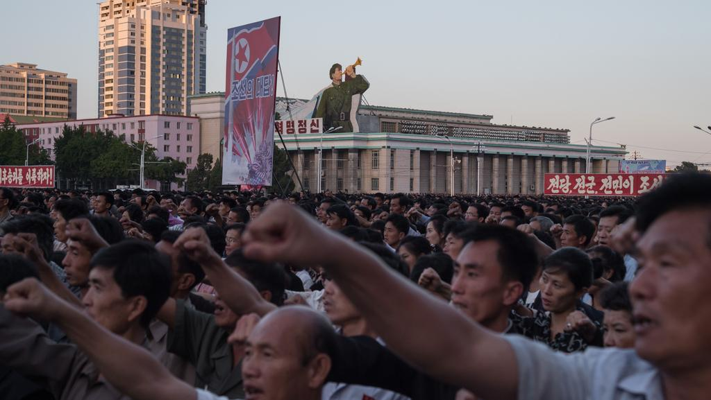 Participants of a mass rally against the US shout slogans as they gather on Kim Il-Sung square in Pyongyang. Picture: AFP