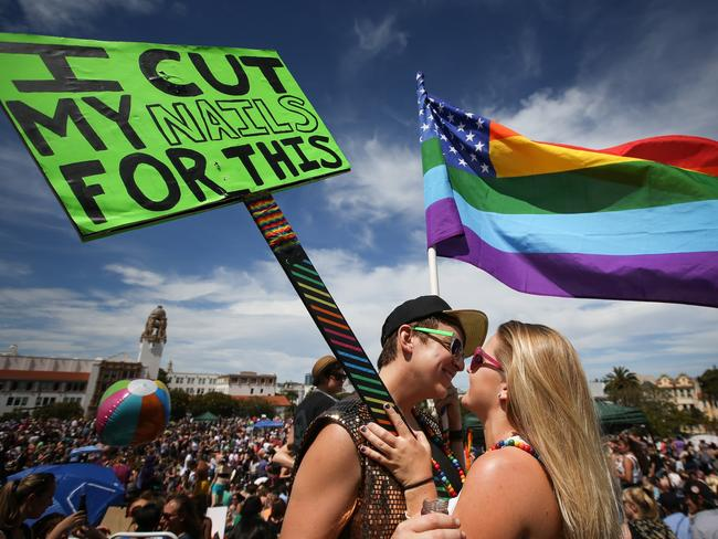 Moving moment ... Lauren Robinson (left) and her girlfriend Kayla Weiss celebrate during a gay pride event in Dolores Park, San Francisco, on June 27. Picture: Elijah Nouvelage/Getty Images/AFP