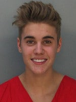 Justin Bieber poses for a booking photo at the Miami-Dade Police Department on January 23, 2014 in Miami, Florida. Justin Bieber was charged with drunken driving, resisting arrest and driving without a valid license after Miami Beach Police found the pop star street racing. (Photo by Miami-Dade Police Department via Getty Images)
