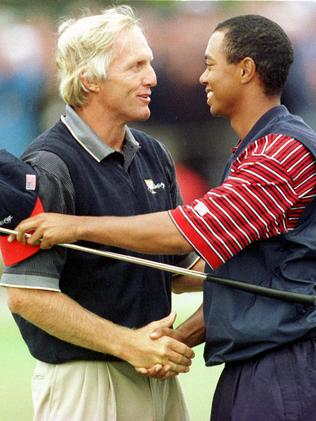 A Shark and a Tiger meet on the golf course during the Internationals 1998 Presidents Cup victory. Picture: AP
