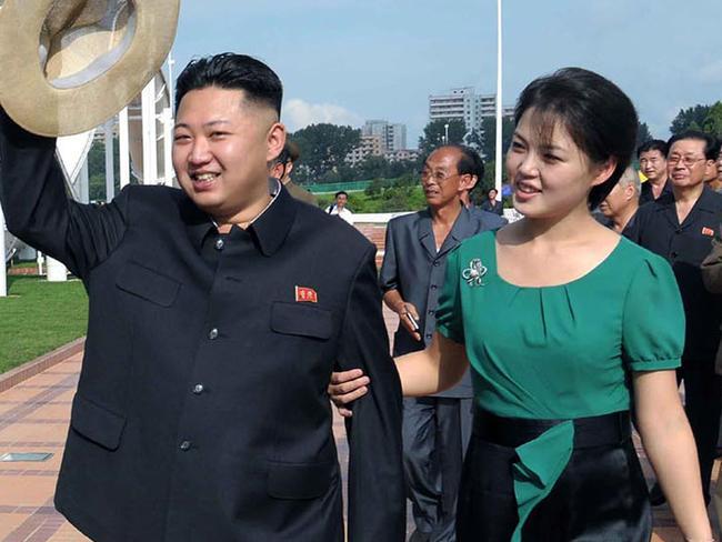 North korean men ordered to copy kim jong uns haircut north korean leader kim jong un with his wife ri sol winobraniefo Images