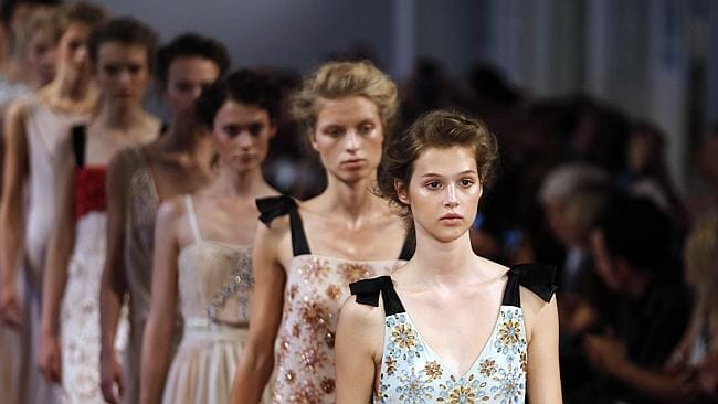 Models present creations by Collette Dinnigan during the 2014 Spring/Summer ready-to-wear collection fashion show in Paris.