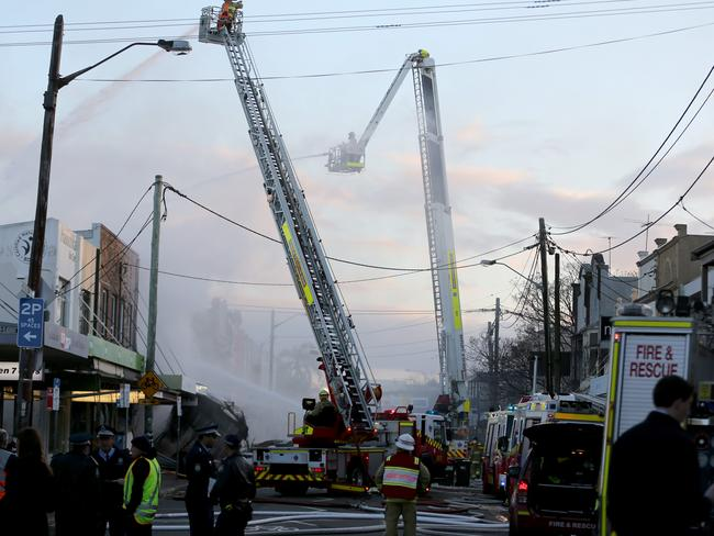 Daylight reveals the full impact of the explosion on the surrounding street. Picture: John Grainger