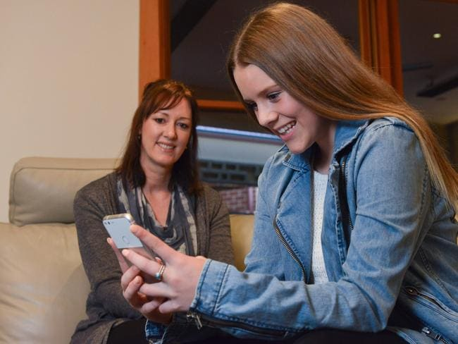 Janine Shipton monitors her 12-year-old daughter Millie's phone use. Picture: AAP/Brenton Edwards