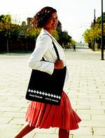 <p>Megan Gale with the Sunday Telegraph David Jones bag in 2006. </p>