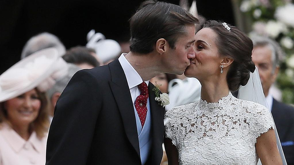 Pippa Middleton and James Matthews kiss after their wedding at St Mark's Church in Englefield, England. Picture: Kirsty Wigglesworth