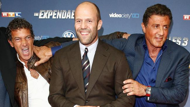 Antonio Banderas, Statham and Sylvester Stallone play up for the cameras at the German premiere. Picture: Getty
