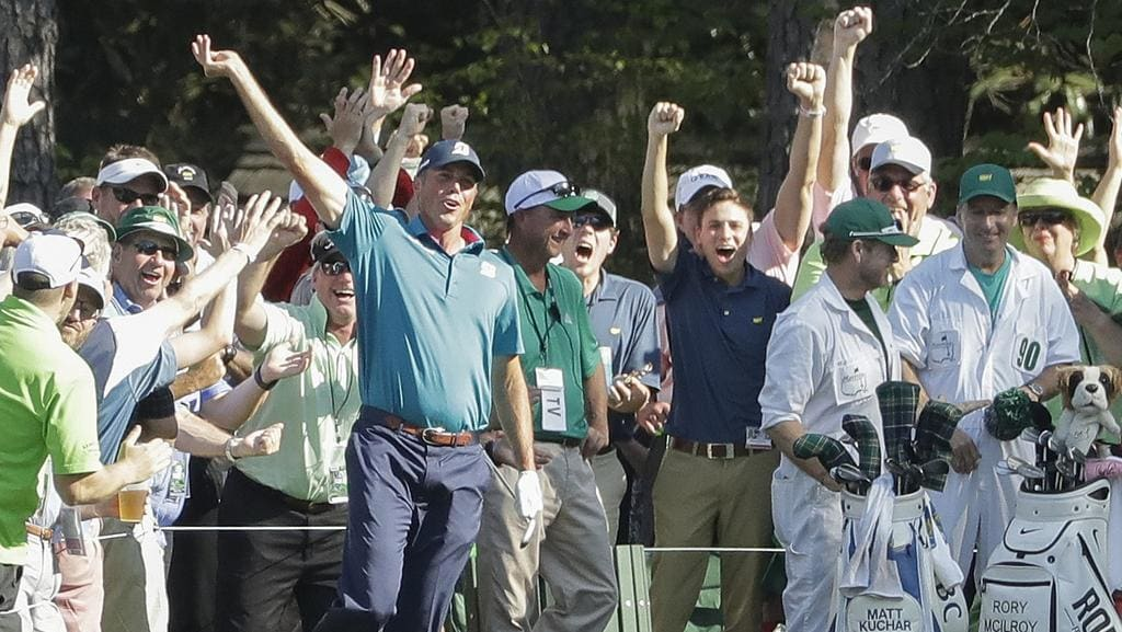 Matt Kuchar reacts after his hole in one on the 16th