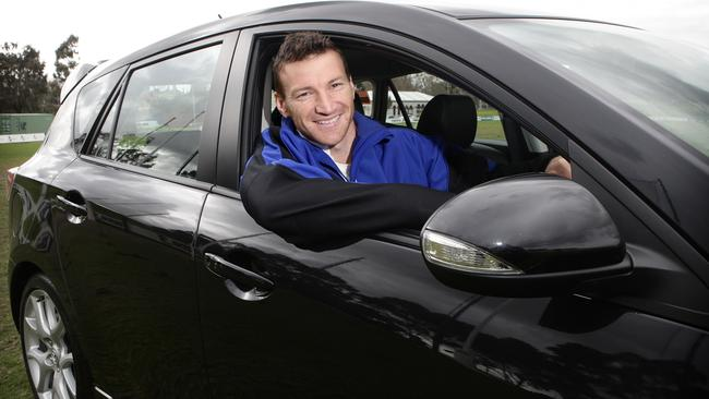 Harvey pictured here in 2009 promoting North Melbourne's sponsor Mazda. Picture: Rebecca Michael