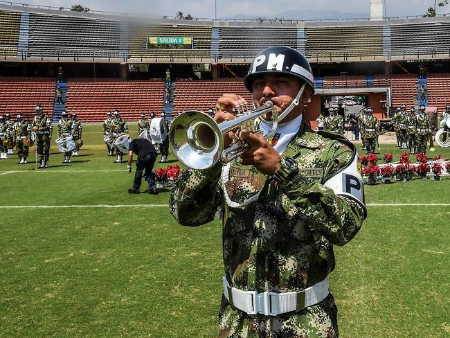 A member of the Colombian Army plays the trumpet during a tribute to the victims.