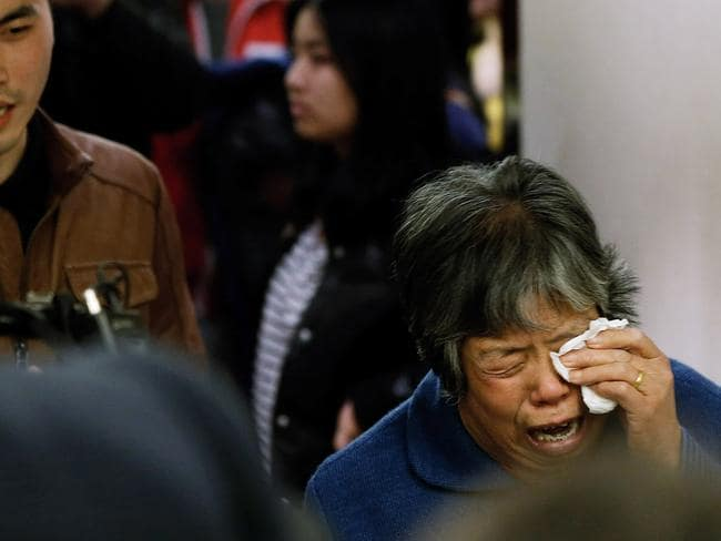 Desperate for answers ... a family member of a passenger from the missing Malaysia Airlines flight.