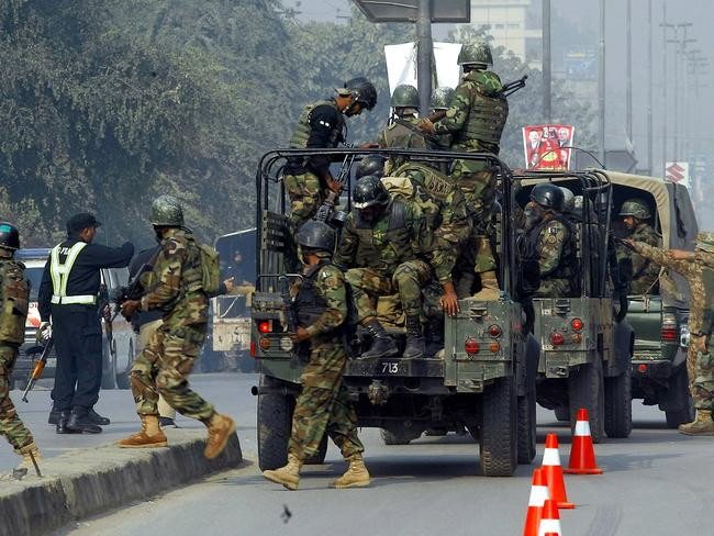 On the scene ... Pakistani army troops arrived quickly to conduct an operation at the school. Picture: AP/Mohammad Sajjad