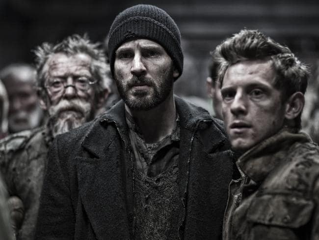 John Hurt, Chris Evans and Jamie Bell are at the wrong end of a luxury train in  <i>Snowpiercer</i>.