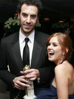Winning actor ... Sacha Baron Cohen and Isla Fisher smile as he holds his best actor Golden Globe for Borat. Picture: Supplied