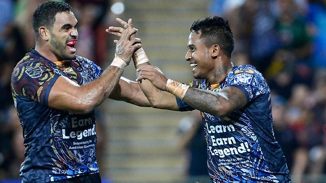 Indigenous All Stars fullback Ben Barba celebrates a try with teammate Greg Inglis. Picture: Bradley Kanaris