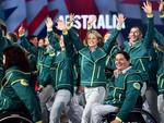 The Australian athletes smile as they arrive during the Opening Ceremony for the Glasgow 2014 Commonwealth Games at Celtic Park on July 23, 2014 in Glasgow, Scotland. (Photo by Jeff J Mitchell/Getty Images)