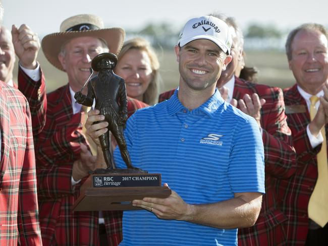 Wesley Bryan holds the trophy after winning RBC Heritage golf tournament.