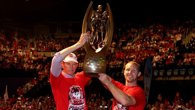 Wayne Bennett and Ben Hornby show off the Telstra Premiership trophy to the fans packing the WIN Entertainment Centre in Wollongong in 2010.