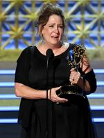 """LOS ANGELES, CA - SEPTEMBER 17: Actor Ann Dowd accepts the Outstanding Supporting Actress in a Drama Series for """"The Handmaid's Tale"""" onstage during the 69th Annual Primetime Emmy Awards at Microsoft Theater on September 17, 2017 in Los Angeles, California. (Photo by Kevin Winter/Getty Images)"""