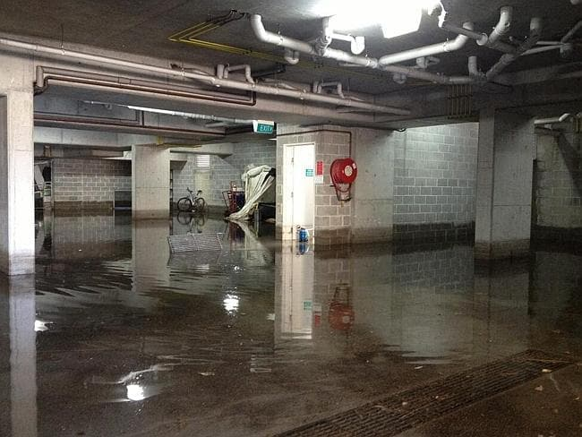 Fire and Rescue NSW crews are working to pump 100,000L of water from this basement carpark. Picture: Twitter