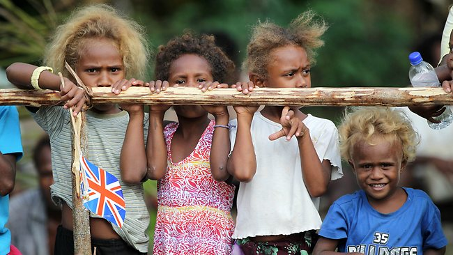 Island children can't wait to greet the couple. Picture: Getty Images