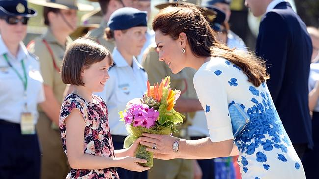 The Duchess of Cambridge receives flowers from 9 year-old Ashleigh Kearnan