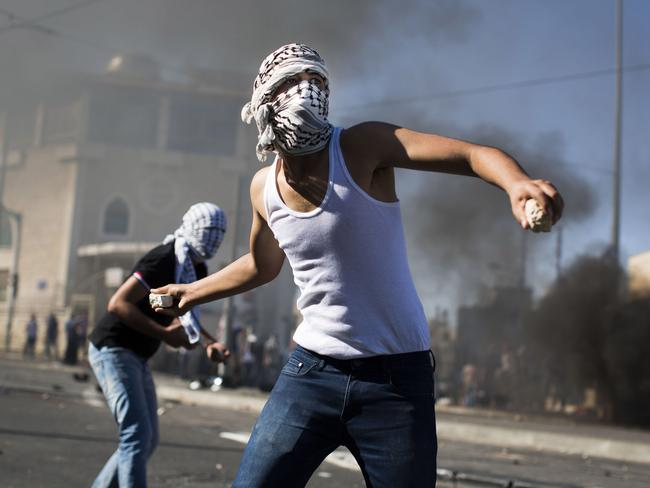 Palestinian youths clash with Israeli Police near to the house of murdered Palestinian teenager Mohammed Abu Khdair. Photo by Ilia Yefimovich/Getty Images.