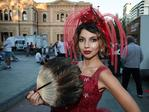 The Red Queen played by Neroli Newton poses for a picture at the Adelaide Fringe parade. AAP Image/MATT LOXTON