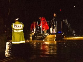 Police and rangers search in the rain overnight. Picture: MICHAEL FRANCHI
