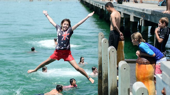 Amy, 12, from Beaconsfield, was among many people who flocked to Frankston Beach to cool down yesterday. Picture: Jason Sammon