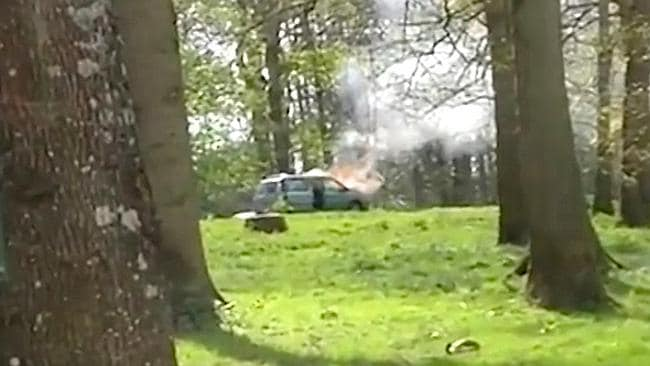 Ablaze ... the family's car goes up in flames in the Longleat Safari Park's lion enclosure.