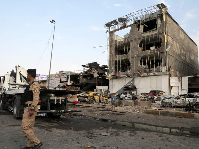Aftermath ... Security forces inspect the site of a car bomb explosion in the largely Shiite eastern neighbourhood of Talibiyah in Baghdad. Pic: AP Photo/Khalid Mohammed