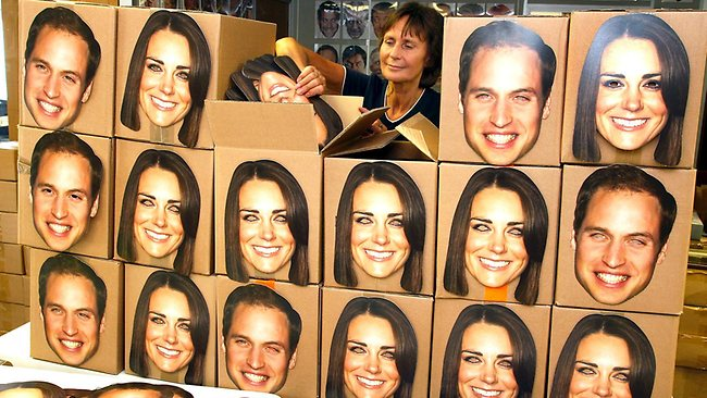 Pam Cooper from the Mask-arade mask company loads boxes of Prince William and Kate, Duchess of Cambridge masks. Normally, the company has 2000 masks on hand. But for the royal birth, they will whip up 20,000 to meet the expected demand.