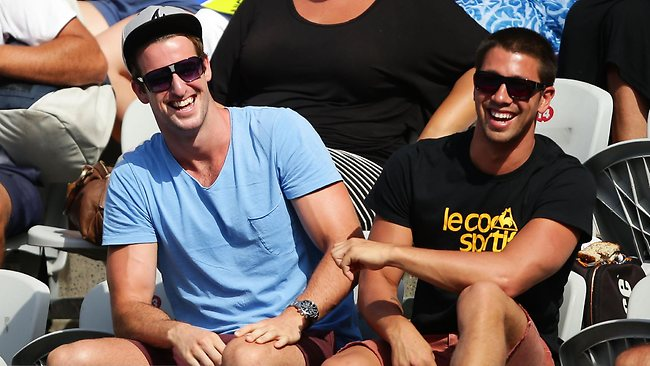 Swimmer James Magnussen, left, watches good mate Bernard Tomic at the Sydney International.