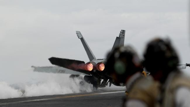 An FA-18 leaves the flight deck of the USS George Washington Aircraft Carrier. Picture: Jeff Camden