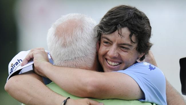 Safe bet: Rory McIlroy hugs his father Gerry on the 18th green after winning the U.S. Open Championship golf tournament in Bethesda in 2011. (AP Photo/Nick Wass)